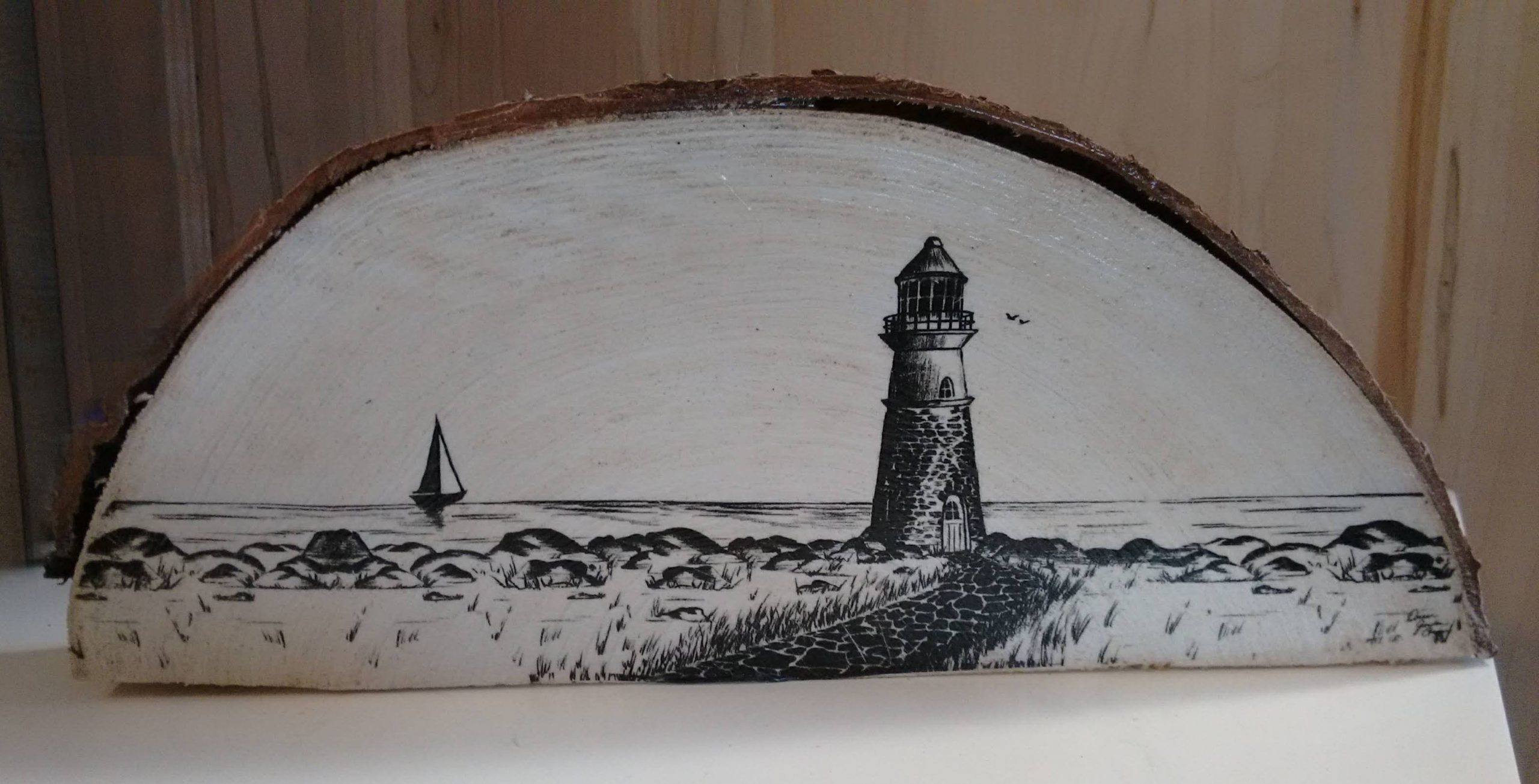 Lighthouse on wood slice