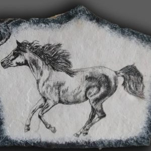 drawing of horse on stone