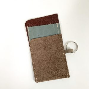 brown and grey leather card holder