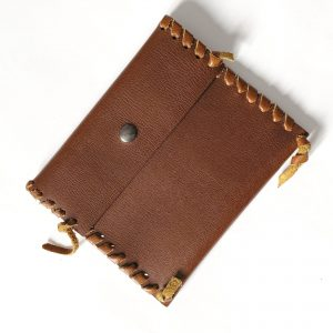 Hand bound brown leather pouch