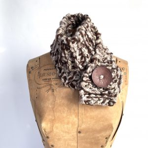 Brown, tan scarf with brown button.