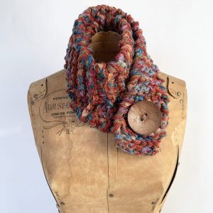 Scarf in burnt orange, blue and green with brown button