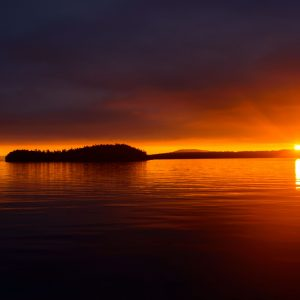 Sunrise and Sunbeams in front of island silhouettes