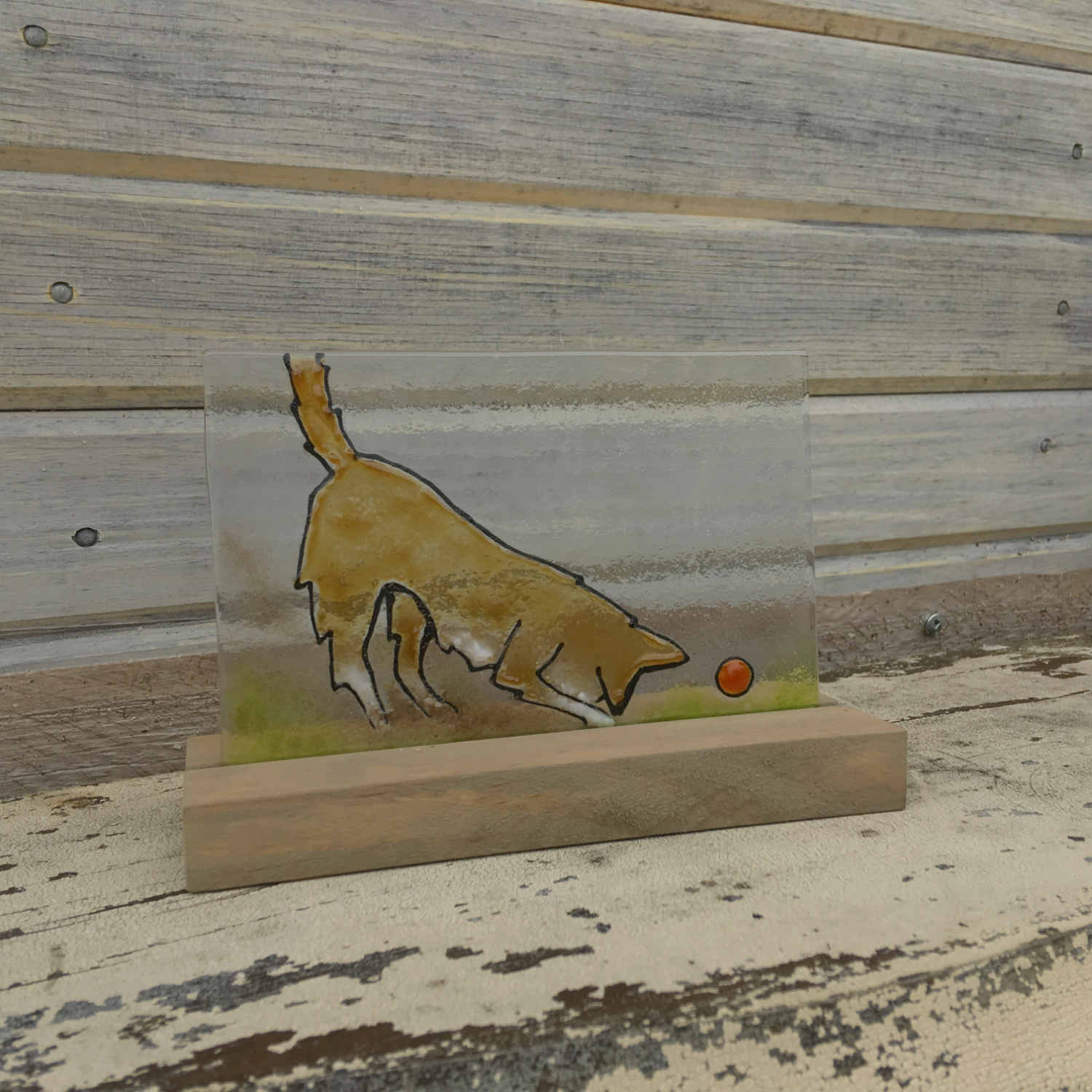 Glass tile featuring Brown dog with red ball