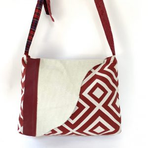 Red and cream leather flap messenger bag