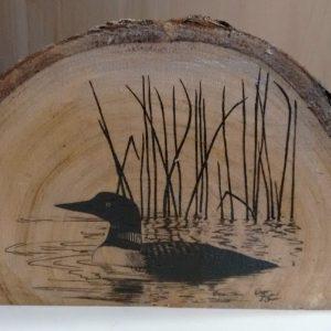 loon drawing on live edge wood slice
