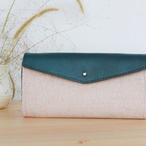 teal leather and pink fabric wallet