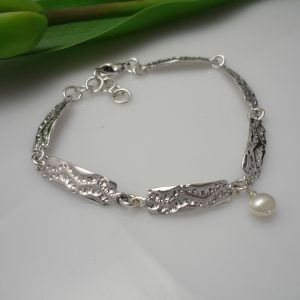 Sterling silver and pearl charm link lace design bracelet