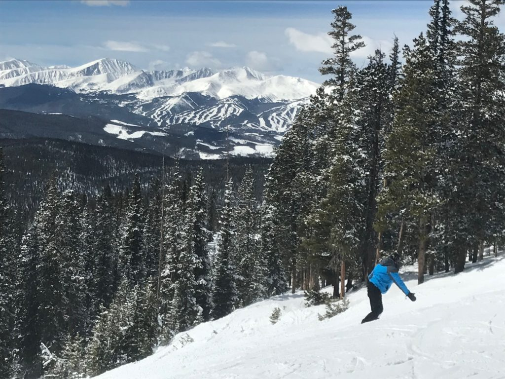 A snowboarder on North Peak at Keystone Resort