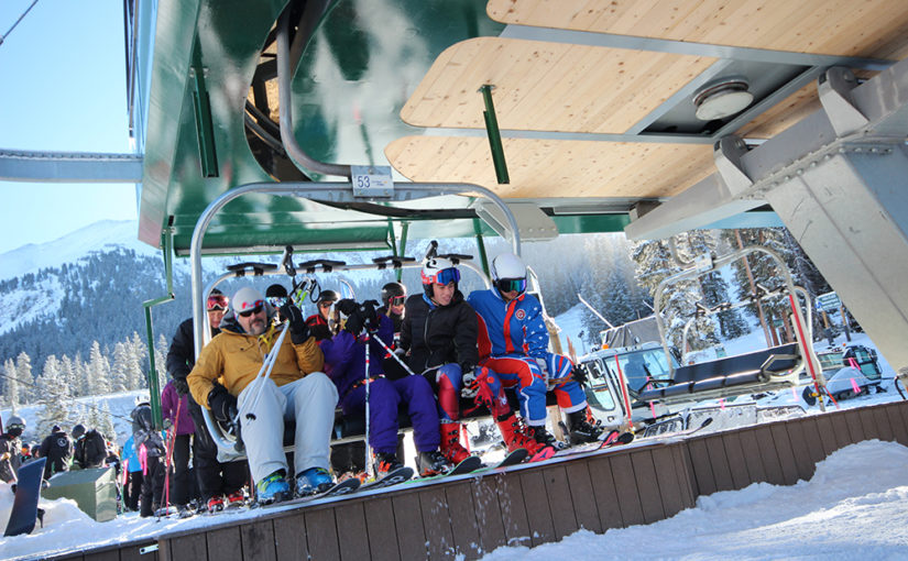 Skiers and Riders on the Black Mountain Express Chair Lift