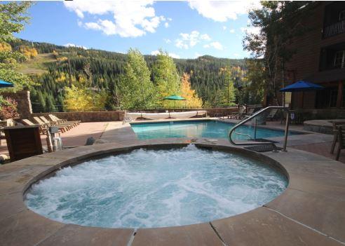 View of the pool and hot tub at Dakota Lodge
