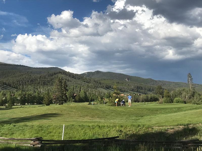 Golfers at Keystone River Golf Course in Colorado