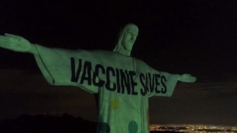 Rio's Christ the Redeemer lit up with Vaccine Saves sign