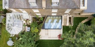 Faceted-roof-casts-zigzagging-shadows-over-London-house-extension